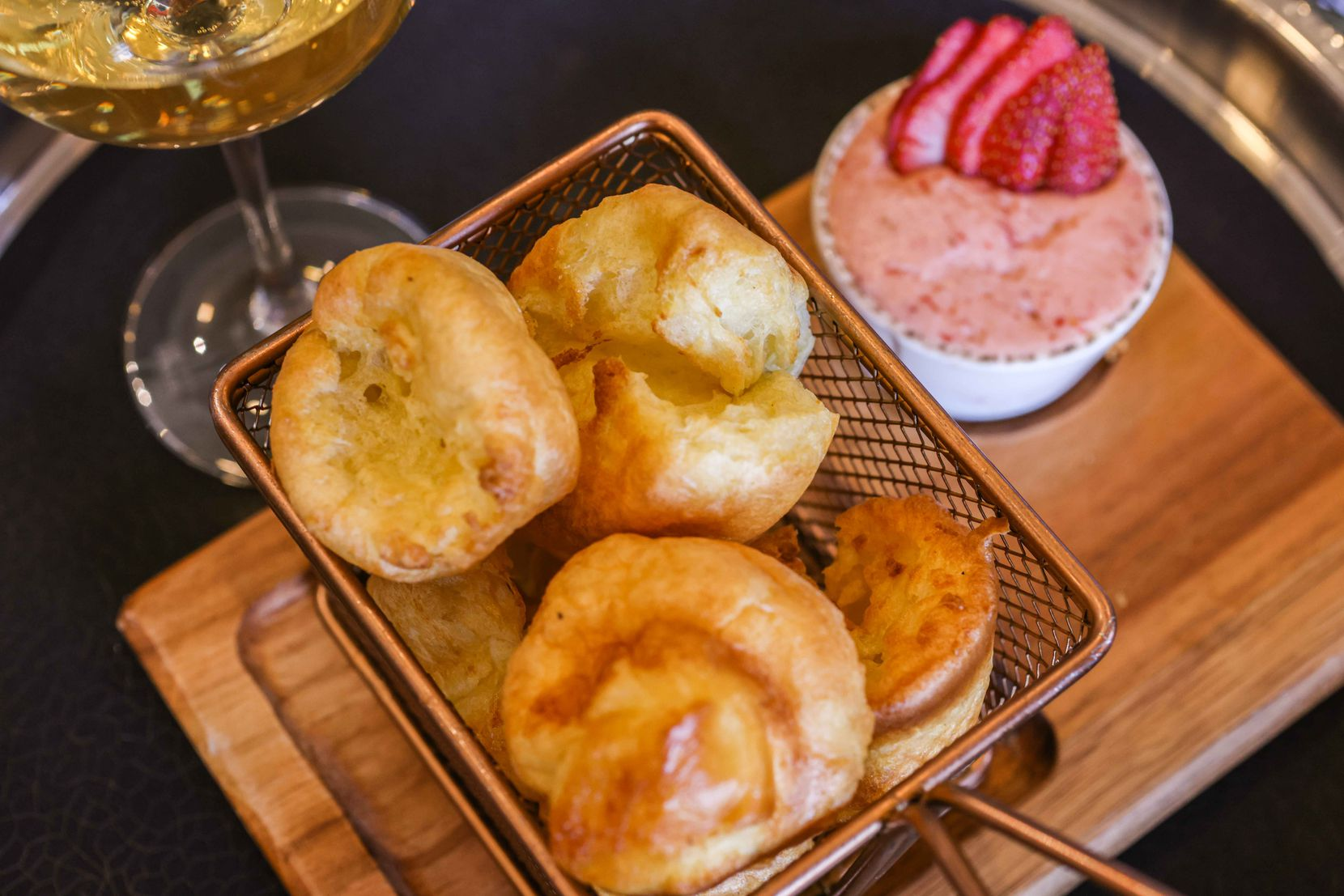 Miniature popovers with strawberry and Texas honey compound butter by Herd and Hearth on Friday, March 19, 2021.