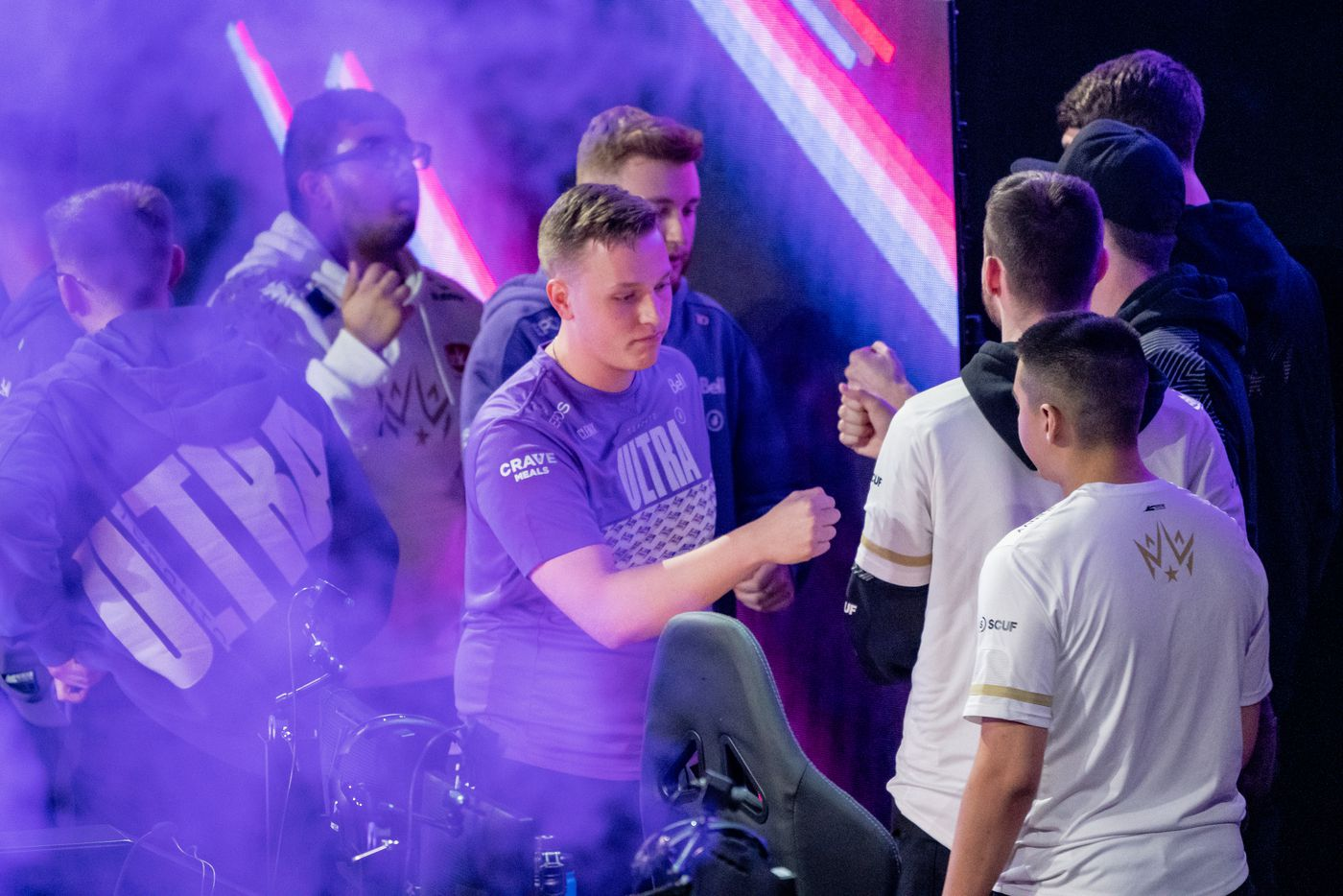Members of the Dallas Empire bumps fists with members of the Toronto Ultra after the Empire's elimination from the  Call of Duty league playoffs at the Galen Center on Saturday, August 21, 2021 in Los Angeles, California. The Empire lost to Ultra 2 - 3, eliminating them from the tournament. (Justin L. Stewart/Special Contributor)