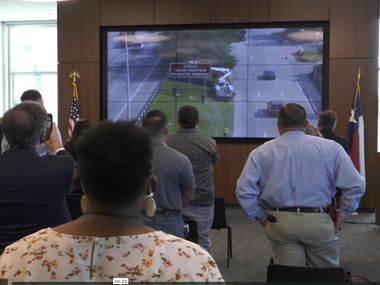 Attendees of the virtual ceremony for the dedication of the Officer David Sherrard Memorial Highway in Richardson watch as the naming signs are unveiled.
