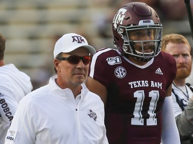Texas A&M Aggies head coach Jimbo Fisher and quarterback Kellen Mond (11) participate in warm ups prior to a college football game between Texas A&M and Texas State on Thursday, Aug. 29, 2019 at Kyle Field in College Station, Texas. (Ryan Michalesko/The Dallas Morning News)