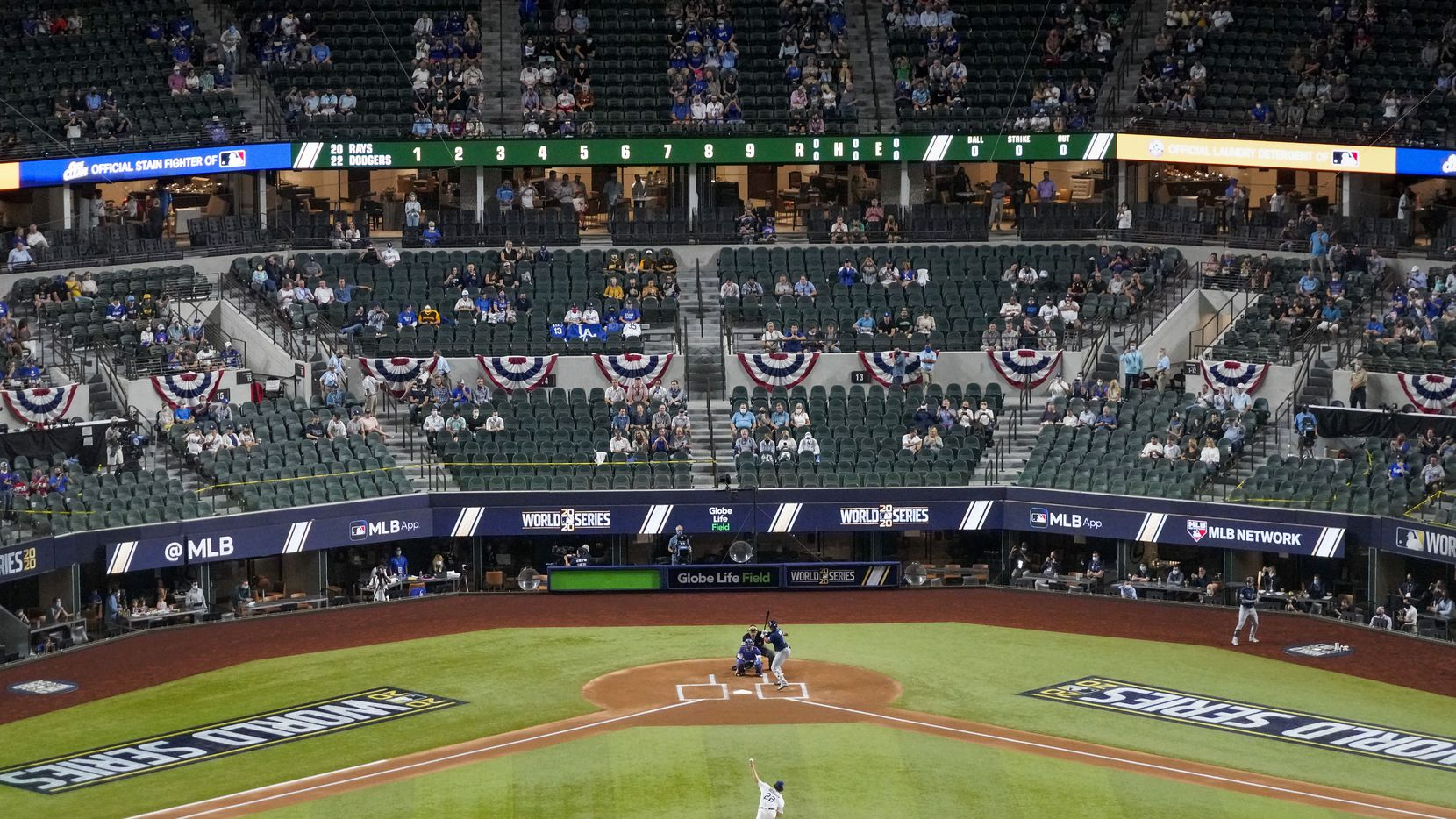 Los Angeles Dodgers starting pitcher Clayton Kershaw throws the first pitch of the game to Tampa Bay Rays first baseman Yandy Diaz during the first inning in Game 1 of the World Series at Globe Life Field on Oct. 20, 2020.
