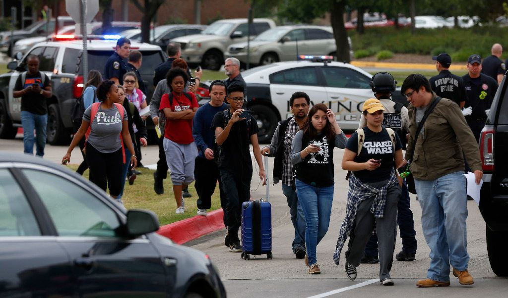 Students walk out of a building at North Lake College.