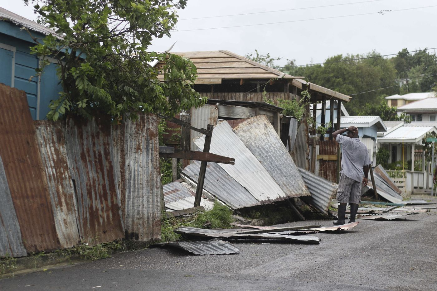 A man surveys the wreckage on his property after the passing of Hurricane Irma, in St. John's, Antigua and Barbuda, on Wednesday.