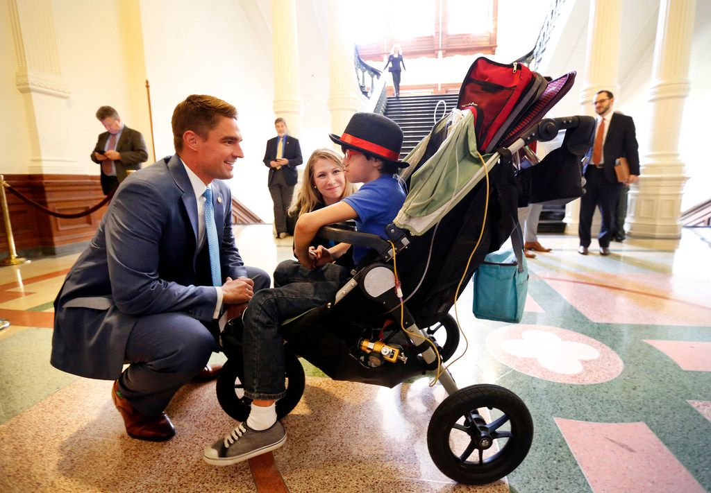 Rep. Jeff Leach, R-Plano, came off the floor to meet nine yr-old Aiden and his mother Hannah Mehta during a visit to the Texas State Capitol in Austin. Leach is the lead author of the Texas Born-Alive Infant Protection Act, which could result in doctors being sued and fined for not attempting to save the life of an infant born after an abortion. (Tom Fox/The Dallas Morning News)