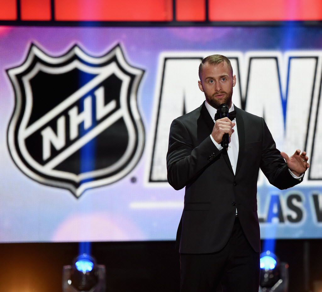 Rich Peverley of the Dallas Stars presents the Bill Masterson Memorial Trophy on stage during the 2014 NHL Awards at the Encore Theater at Wynn Las Vegas on June 24, 2014 in Las Vegas, Nevada.