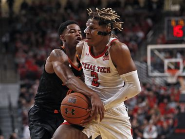 Oklahoma State's Avery Anderson III (0) tries to steal the ball away from Texas Tech's Jahmi'us Ramsey (3) during the first half of a game on Saturday, Jan. 4, 2020, in Lubbock.