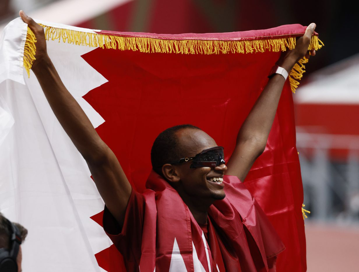 Qatar's Mutaz Essa Barshim celebrates after winning a gold medal in the men's high jump final during the postponed 2020 Tokyo Olympics at Olympic Stadium, on Sunday, August 1, 2021, in Tokyo, Japan. Barshim will share a gold medal with Italy's Gianmarco Tamberi  who also cleared 2.37 meters in the final. (Vernon Bryant/The Dallas Morning News)
