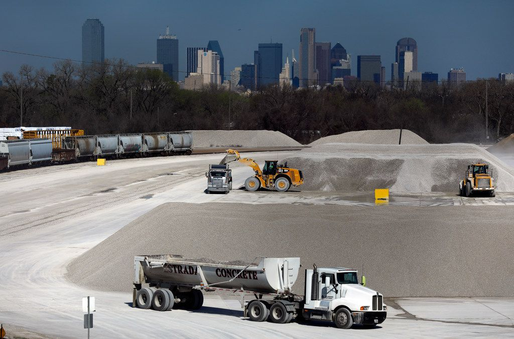 Trucks are loaded with aggregate at Martin Marietta's Miller Yard across the Union Pacific Railroad tracks from Joppa, the historic freedman's town near Loop 12 and 310 in Southeast Dallas.