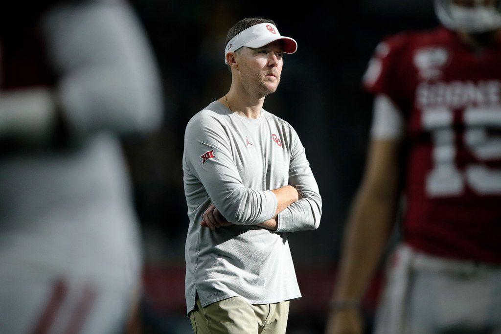 Oklahoma Sooners head coach Lincoln Riley watches his team during warmup before facing the Baylor Bears in the Big 12 Championship at AT&T Stadium in Arlington, Saturday, December 7, 2019.