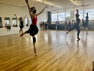 Dancers for Momentum Dance Company practice for their spring show, United We Dance. Performances will be April 16 and 17.
