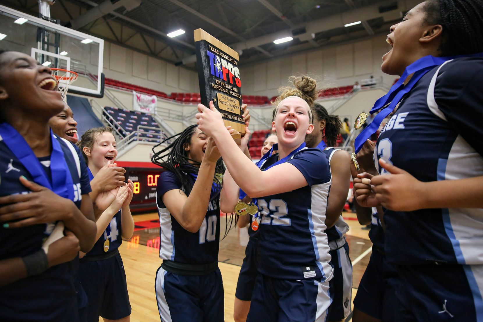 Players from the Village School celebrate after beating Plano Prestonwood Christian during a TAPPS Class 6A girls basketball state championship game on Feb. 28, 2020 in West. Prestonwood lost 75-48.