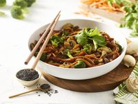 Noodles & Company has a varied menu, including vegan Japanese pan noodles served with broccoli, mushrooms, carrots black sesame seeds and cilantro (pictured here). Noodles & Company has plans to franchise in Texas in 2022 and beyond.