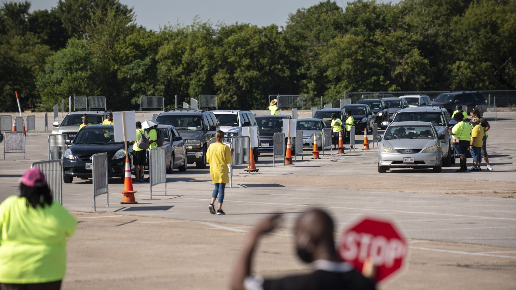 Drivers wait in line to receive school supplies during the Mayor's Back to School Fair drive-through event outside of Fair Park in Dallas, Aug. 21, 2020. Ben Torres/Special Contributor