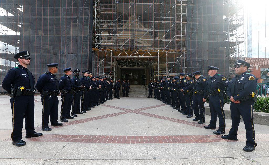 Police officers wait to enter during a public visitation for Officer Rogelio Santander at Cathedral Shrine of the Virgin of Guadalupe in Dallas on Monday April 30, 2018. (Nathan Hunsinger/The Dallas Morning News)