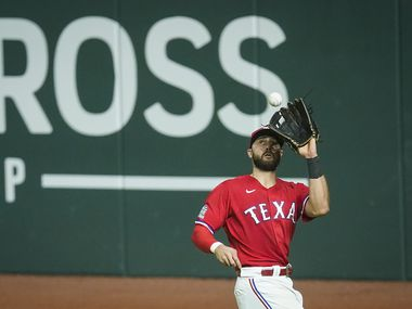 Texas Rangers right fielder Joey Gallo makes the catch on a sacrifice fly off the bat of Houston Astros third baseman Alex Bregman during the tenth inning at Globe Life Field on Friday, Sept. 25, 2020. (Smiley N. Pool/The Dallas Morning News)
