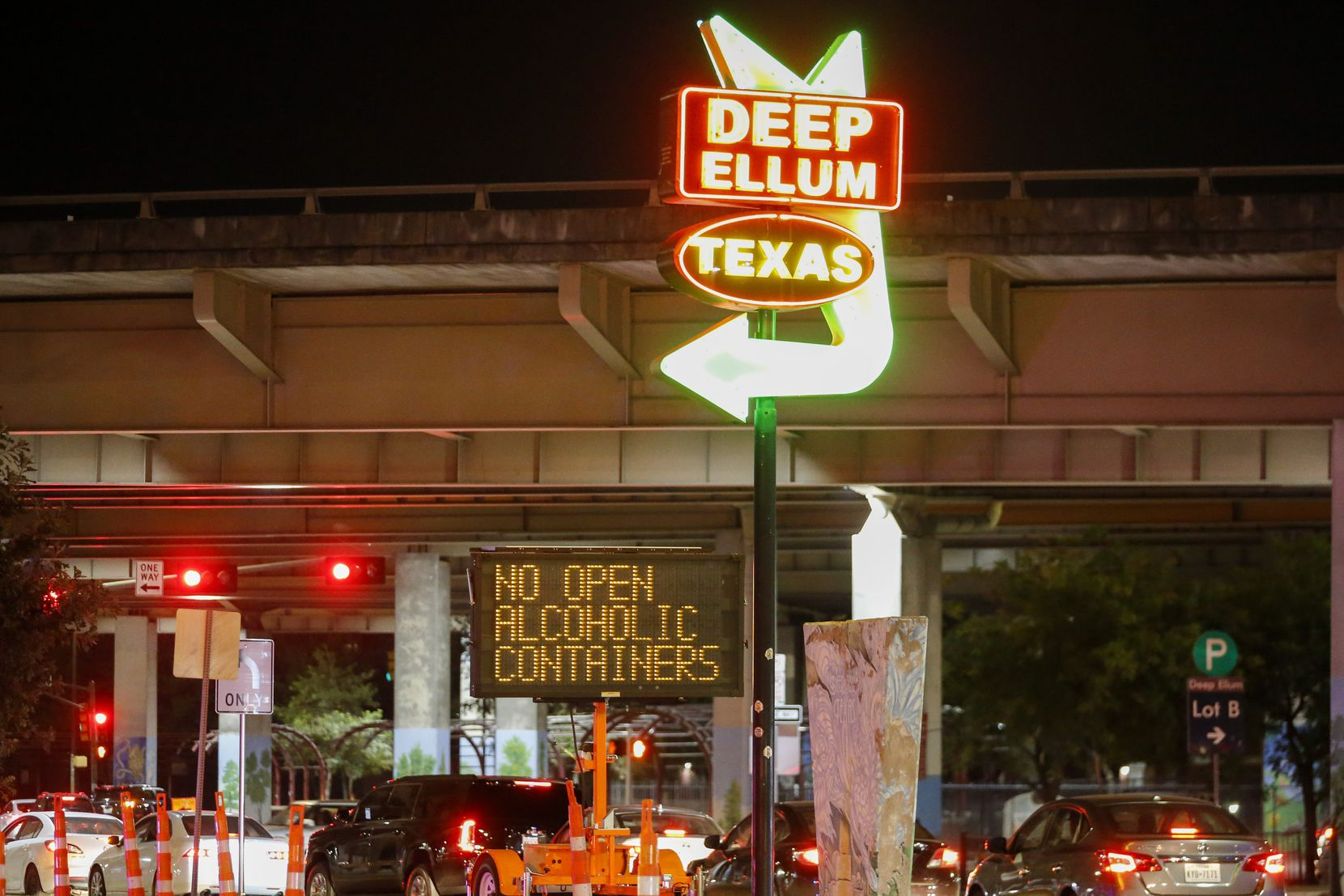 A sign along Good Latimer Expressway in Deep Ellum reminds people of the rule on open containers.
