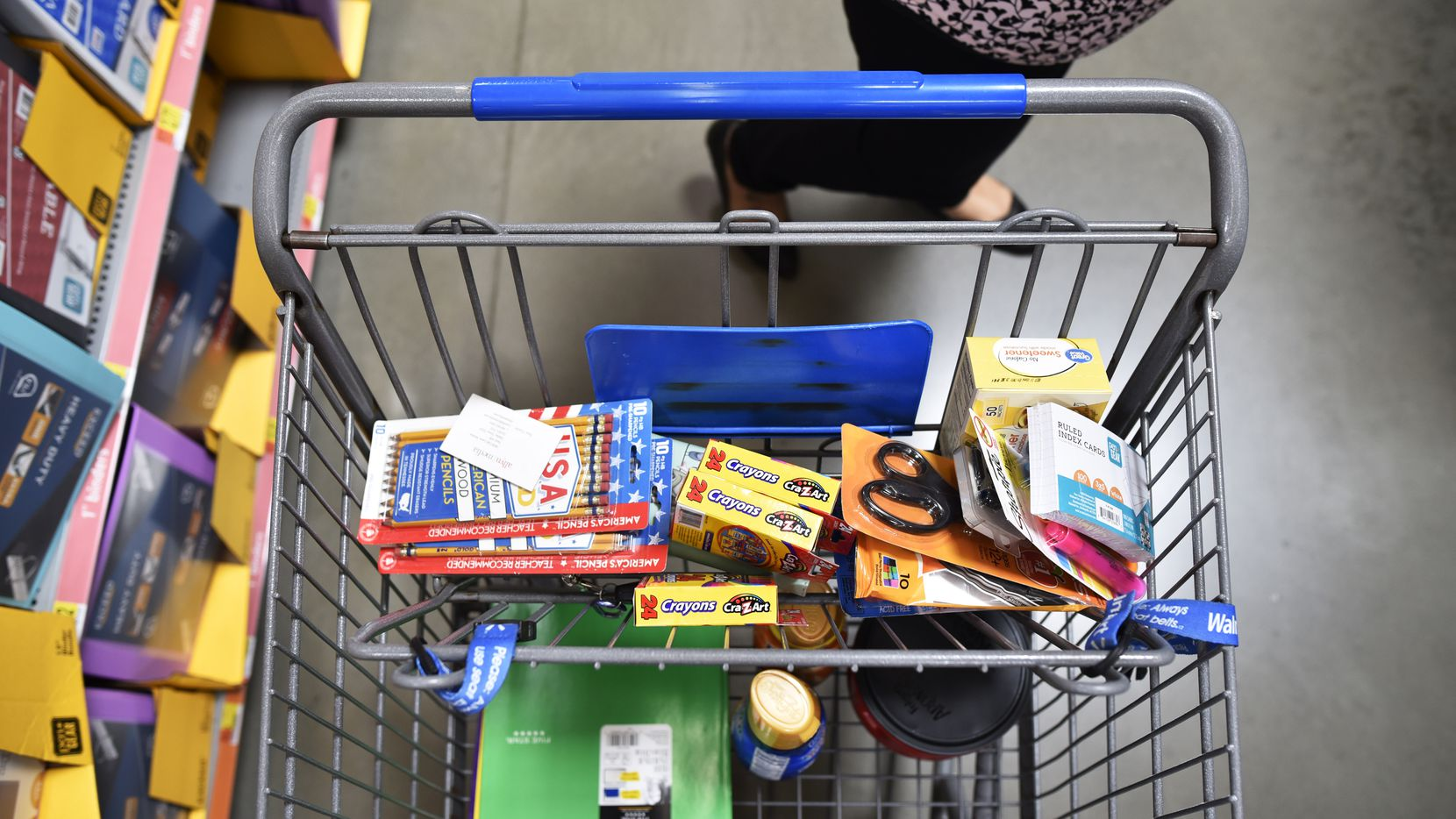 Reyna Jimenez, 30, of Farmers Branch, shopped for school supplies a  Walmart Supercenter off of Lyndon B. Johnson Freeway in North Dallas in 2019. The supplies were to be donated to a raffle at her job.