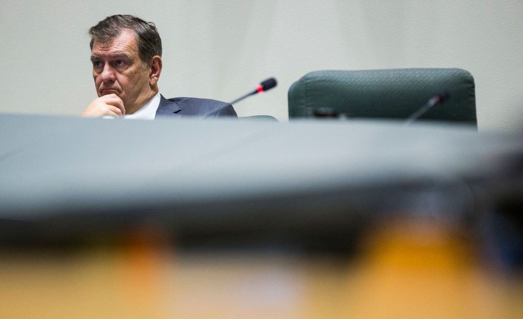 Dallas Mayor Mike Rawlings listens as the Dallas City Council prepares to vote to kill the Trinity River Toll Road on Wednesday, August 9, 2017 at City Hall in Dallas. (Ashley Landis/The Dallas Morning News)