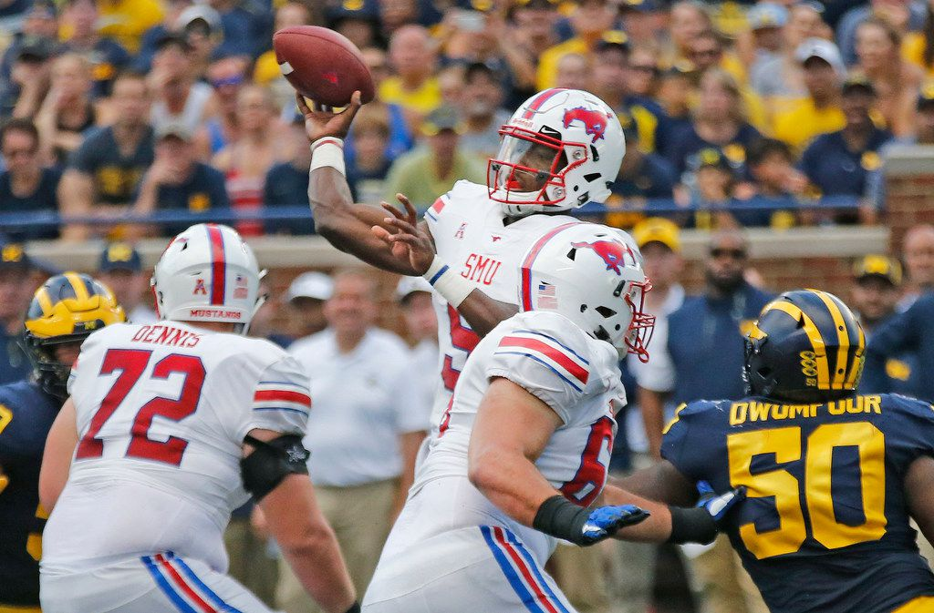 Southern Methodist Mustangs quarterback William Brown (9) throws a pass during the SMU Mustangs vs. the Michigan Wolverines NCAA football game at Michigan Stadium in Ann Arbor, Michigan on Saturday, September 15, 2018. (Louis DeLuca/The Dallas Morning News)