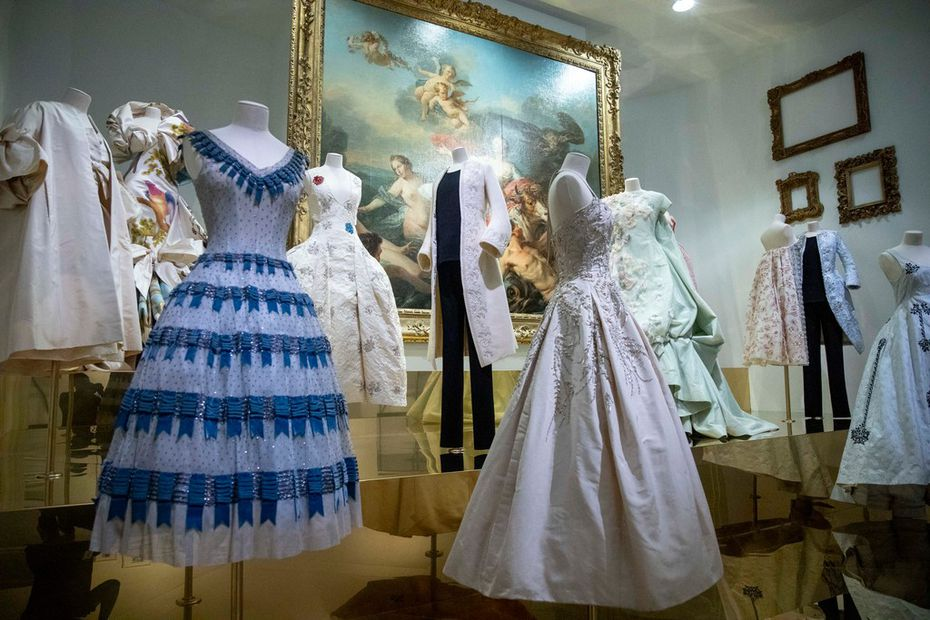 The 17th century section of exhibit includes garments displayed against the backdrop of paintings from the period. (Shaban Athuman/Staff Photographer)