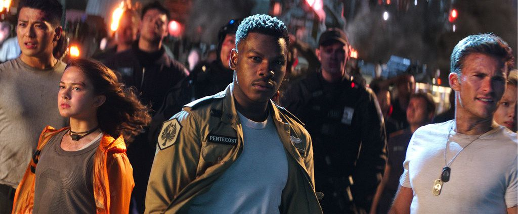 """This image released by Universal Pictures shows, foreground from left, Cailee Spaeny, John Boyega and Scott Eastwood in a scene from """"Pacific Rim Uprising."""" (Legendary Pictures/Universal Pictures via AP)"""