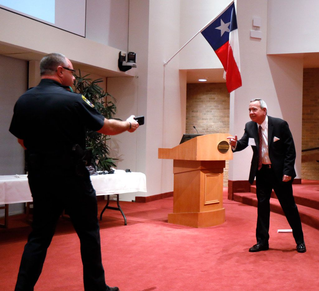 Capt. Dan Birbeck of the Dallas County Hospital District Police Department (left) created a live shooter scenario with Steve Love, president and CEO of the Dallas-Fort Worth Hospital Council, during the council's active shooter training seminar Wednesday at Texas Scottish Rite Hospital for Children.
