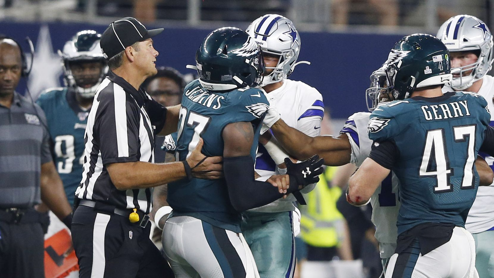 Dallas Cowboys quarterback Dak Prescott (4) gets into a argument with \Philadelphia Eagles strong safety Malcolm Jenkins (27) during the second half of play at AT&T Stadium in Arlington, Texas on Sunday, October 20, 2019. Dallas Cowboys defeated the Philadelphia Eagles 37-10. (Vernon Bryant/The Dallas Morning News)
