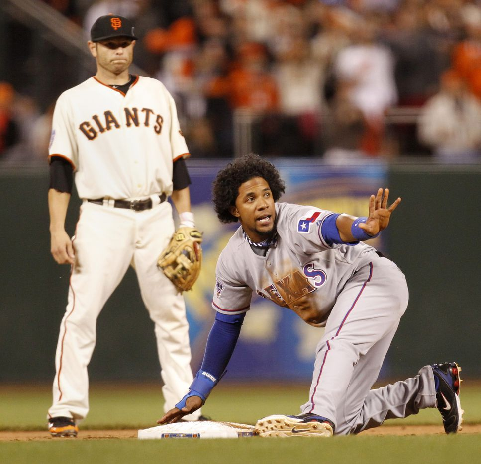 Texas Rangers Elvis Andrus steals second base in the eighth inning as San Francisco Giants second baseman Freddy Sanchez stands by during World Series game two on October 28, 2010, at AT&T Park in San Francisco, California.   (Vernon Bryant/The Dallas Morning News)
