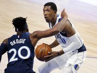 Dallas Mavericks guard Josh Richardson (0) looks to shoot over Minnesota Timberwolves forward Josh Okogie (20) during the first quarter of a preseason game at the American Airlines Center in Dallas, Thursday, December 17, 2020. (Tom Fox/The Dallas Morning News)