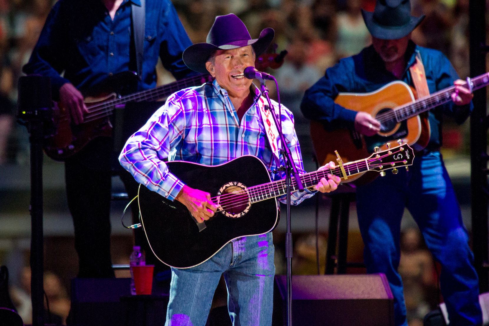 George Strait performs during his what was billed as a farewell tour at AT&T Stadium in Arlington, Texas, Saturday, June 7, 2014.