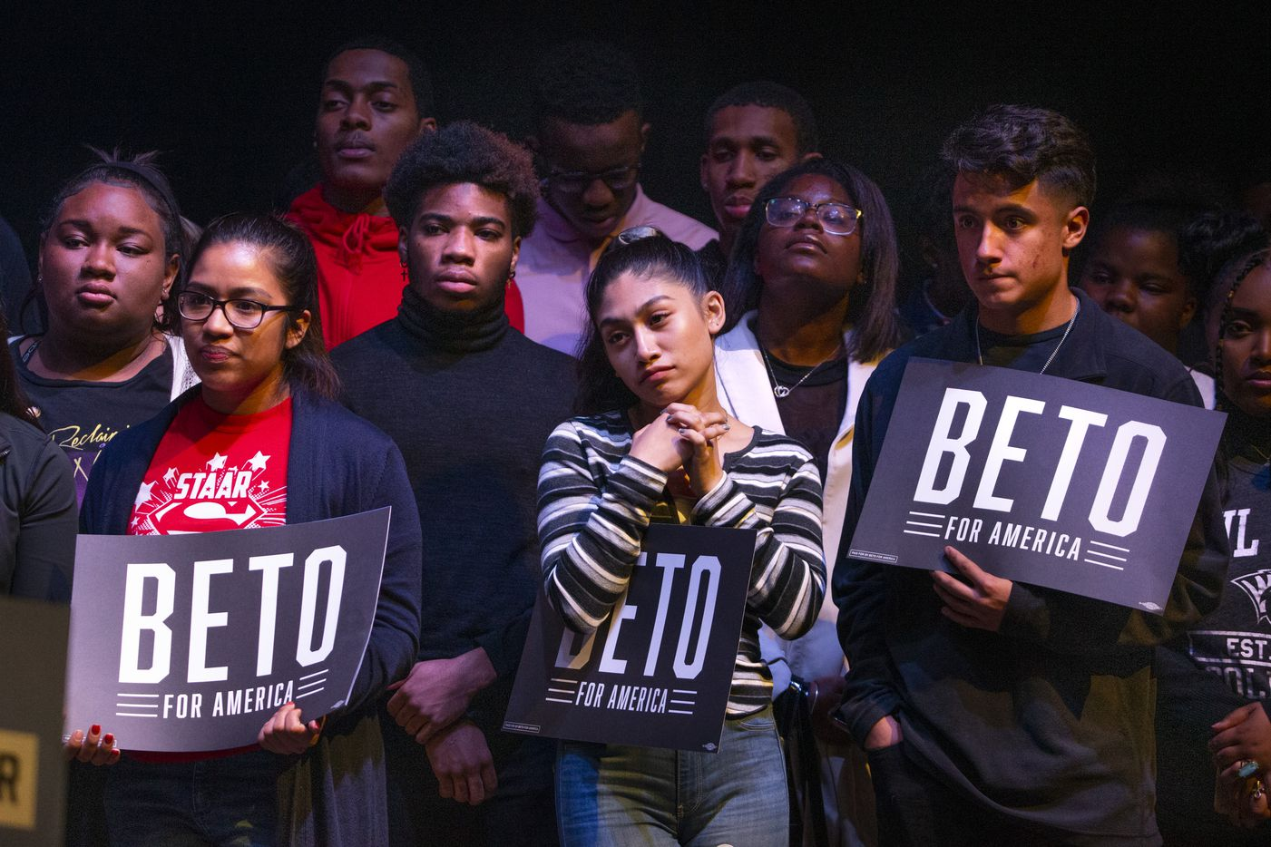 Supporters listen to democratic presidential candidate and former Texas Rep. Beto O'Rourke address the crowd at the Rally Against Fear event hosted by O'Rourke's campaign in the Theatre at Grand Prairie on Thursday, Oct. 17, 2019, in Grand Prairie, Texas. O'Rourke hosted the event in response to President Donald Trump's rally in downtown Dallas at the same time.