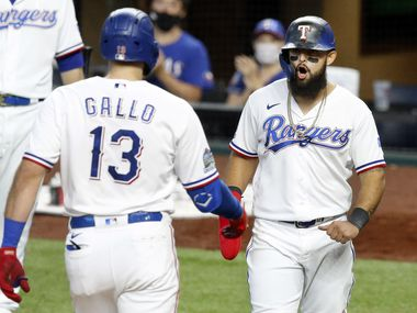 Texas Rangers Joey Gallo (13) is congratulated by teammate Rougned Odor after hitting a two-run homer against the Arizona Diamondbacks in the eighth inning at Globe Life Field in Arlington, Texas, Wednesday, July 29, 2020. Odor scored on the play to take the lead.