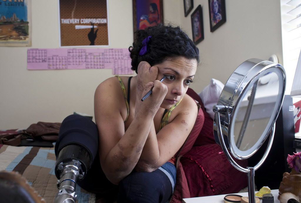Jamie Schanbaum puts on make up on Saturday, March 12, 2011 in Austin, Texas. Schanbaum, 22, survived meningitis after losing her legs and fingers to the disease two years ago.