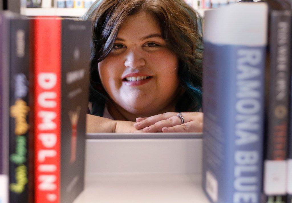 Julie Murphy poses for a portrait at the South Irving Library.