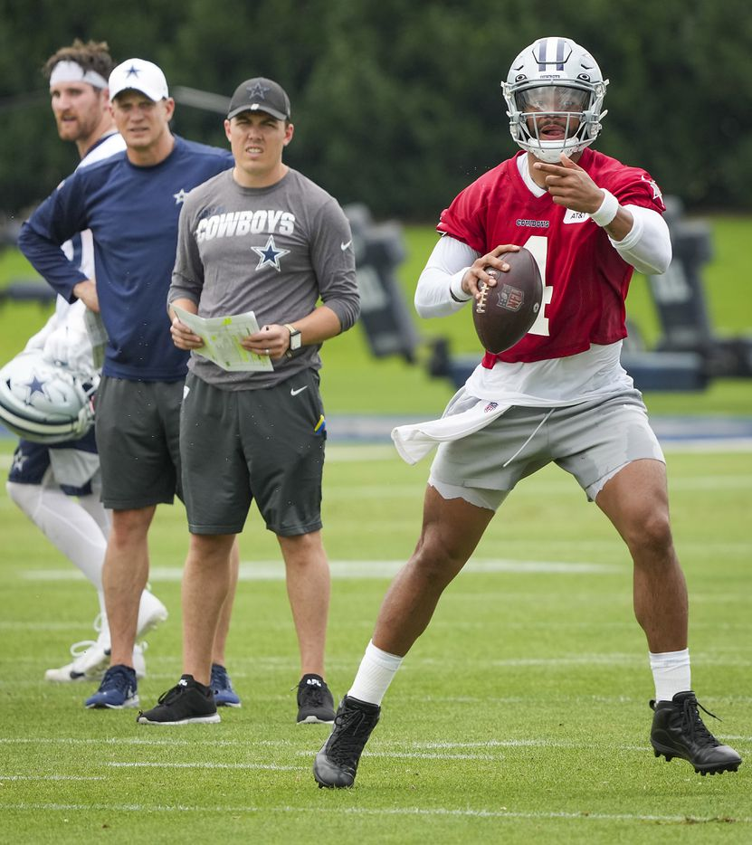 Dallas Cowboys quarterback Dak Prescott (4) runs a drill as offensive coordinator Kellen Moore (center) and quarterbacks coach Doug Nussmeier look on during a minicamp practice at The Star on Wednesday, June 9, 2021, in Frisco. (Smiley N. Pool/The Dallas Morning News)