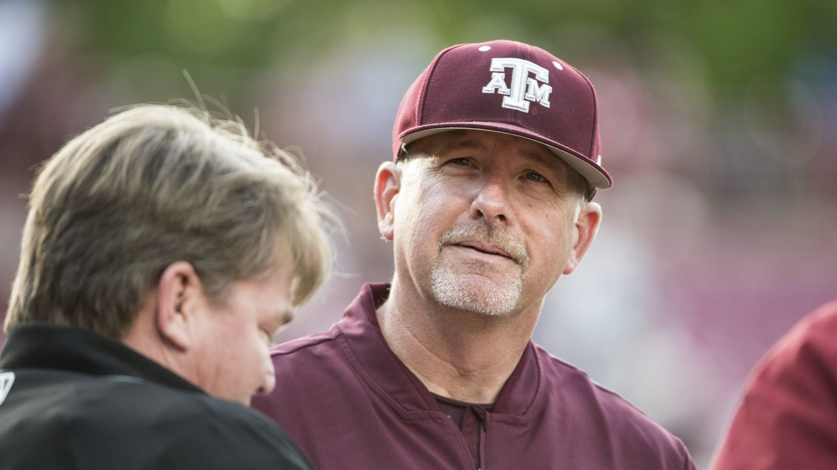 Texas A&M head coach Rob Childress listens during the plate meeting before an NCAA college baseball game, Thursday, April 18, 2019, in Columbia, S.C.