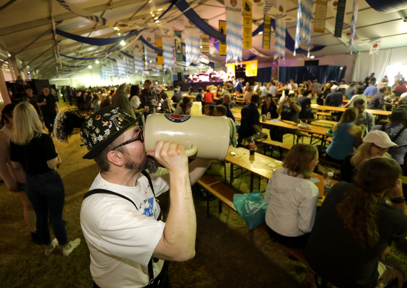 Vinnie Inglhofer drinks from his huge beer stein during the 2018 Addison Octoberfest in Addison.