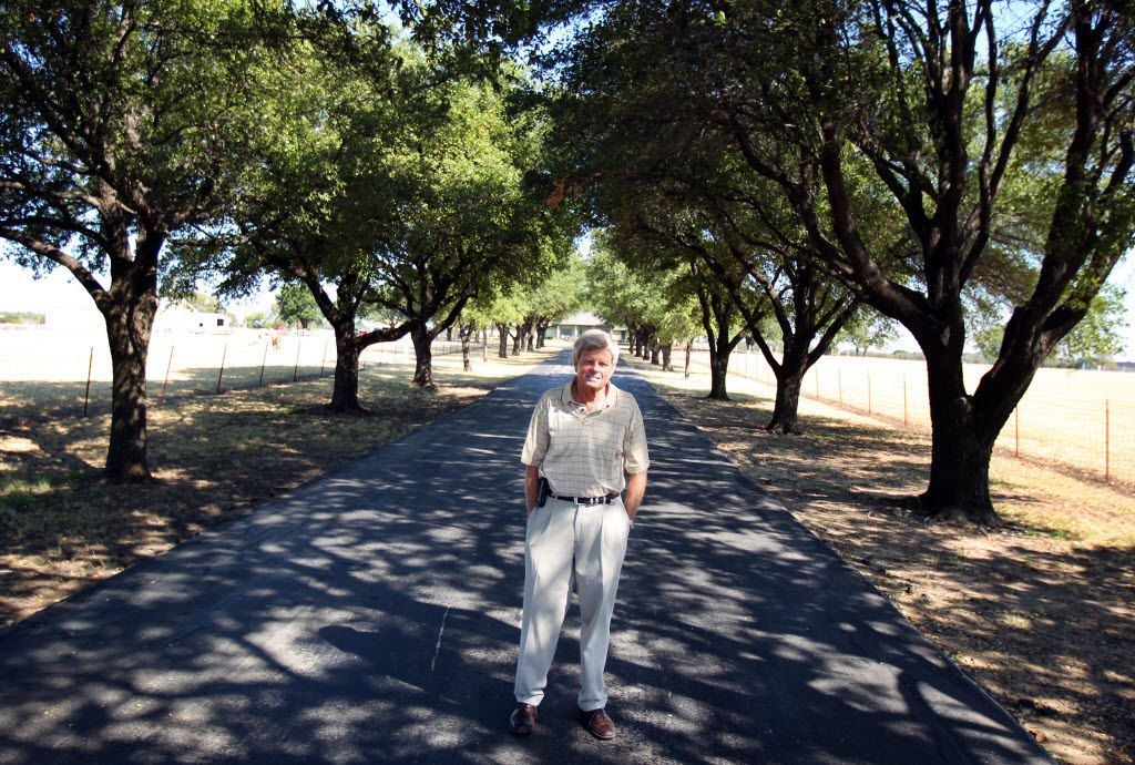 Rodney Haggard stands at the entrance to the Haggard farm in Plano on Sept. 27, 2011, before half of the historic homestead was turned into subdivision housing.