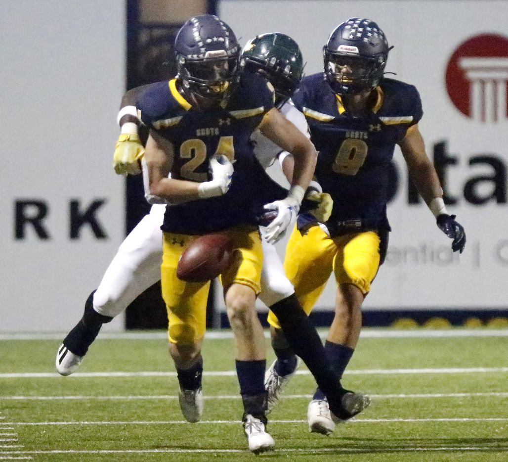 Highland Park High School free safety Preston Taylor (24) fumbles the football after making an interception during the first half as Highland Park High School hosted Longview High School at Highlander Stadium in Dallas on Friday night, October 8, 2021. (Stewart F. House/Special Contributor)