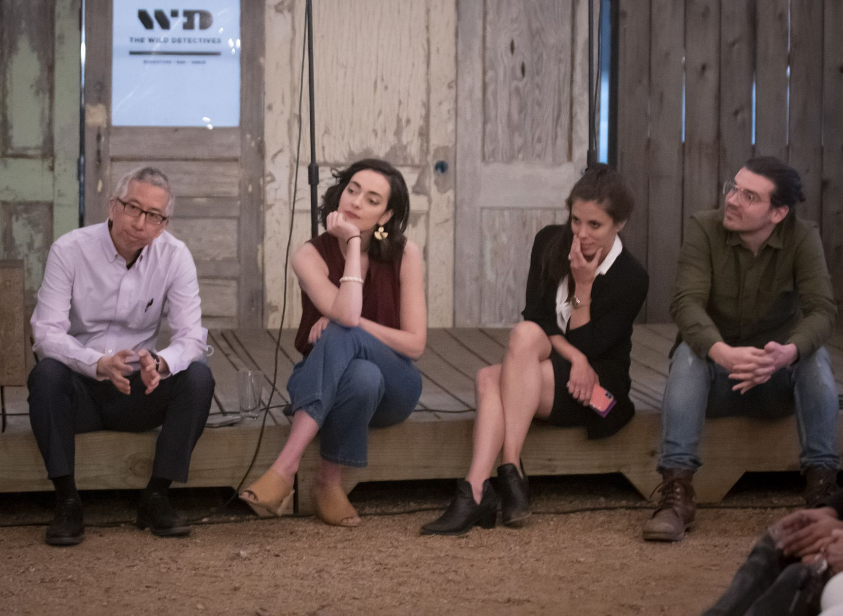Tom Huang (left) of The Dallas Morning News, listens to audience feedback alongside playwright Janielle Kastner, SMU journalism professor Lauren Smart and playwright Brigham Mosley after the workshopping of a play about the newspaper at The Wild Detectives on March 21, 2019.