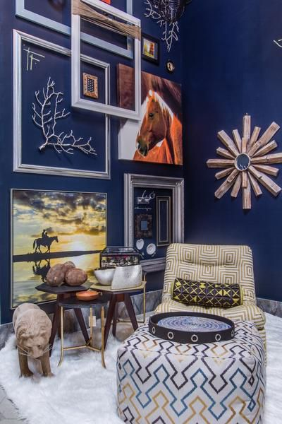 Pickard Design Studio Dark, dramatic walls, the de riguer starburst mirror and a sheepskin rug illustrate current trends.