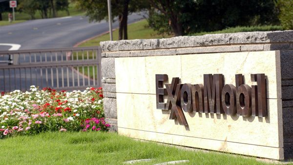 A sign marks the entrance of the Exxon Mobil corporate headquarters in Irving.
