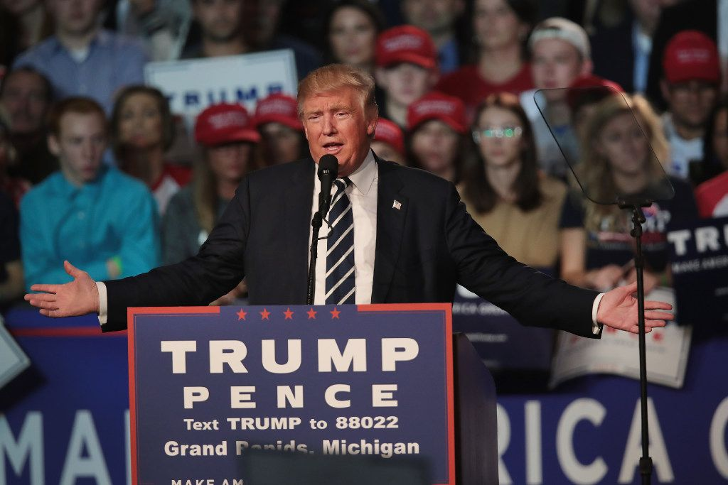 GRAND RAPIDS, MI - NOVEMBER 08:  Republican presidential nominee Donald Trump addresses supporters during a campaign rally on November 8, 2016 in Grand Rapids, Michigan. With less than 24 hours until Election Day in the United States, Trump and his opponent, Democratic presidential nominee Hillary Clinton, are campaigning in key battleground states that each must win to take the White House.  (Photo by Scott Olson/Getty Images)
