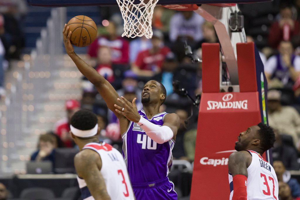 Sacramento Kings forward Harrison Barnes (40) shoots between Washington Wizards guard Bradley Beal (3) and forward Jeff Green (32) during the second half of an NBA basketball game Monday, March 11, 2019, in Washington. (AP Photo/Alex Brandon)