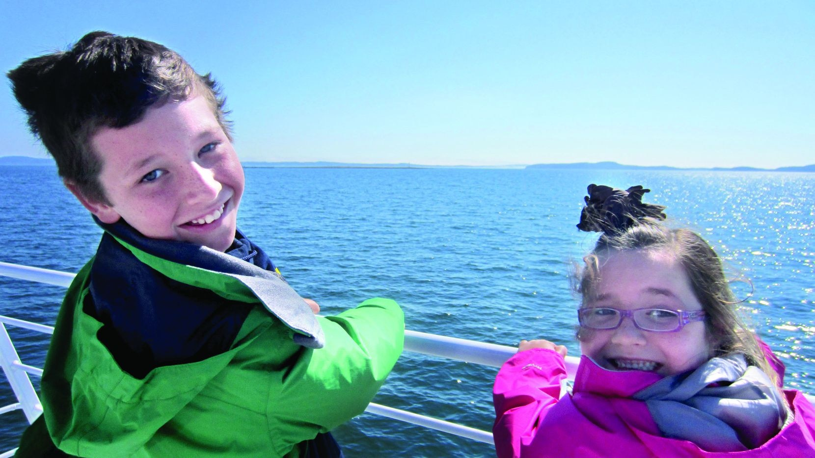 Cooper and Katie Damm hold on tight to the rails of a ferry in Nova Scotia on a Damm family trip Aug. 8, 2012.