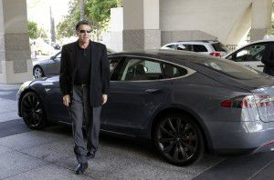 In June 2014, then-Gov. Rick Perry drove up to a news conference in a Tesla Motors Type S electric car in Sacramento, Calif. At the time, Texas was hoping to land Tesla's proposed $5 billion battery factory. (File Photo/The Associated Press)