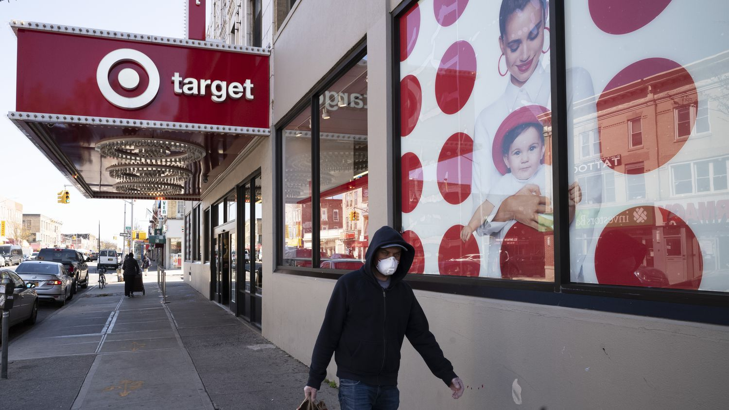 A customer wearing a mask carries his purchases as he leaves a Target store during the coronavirus pandemic,