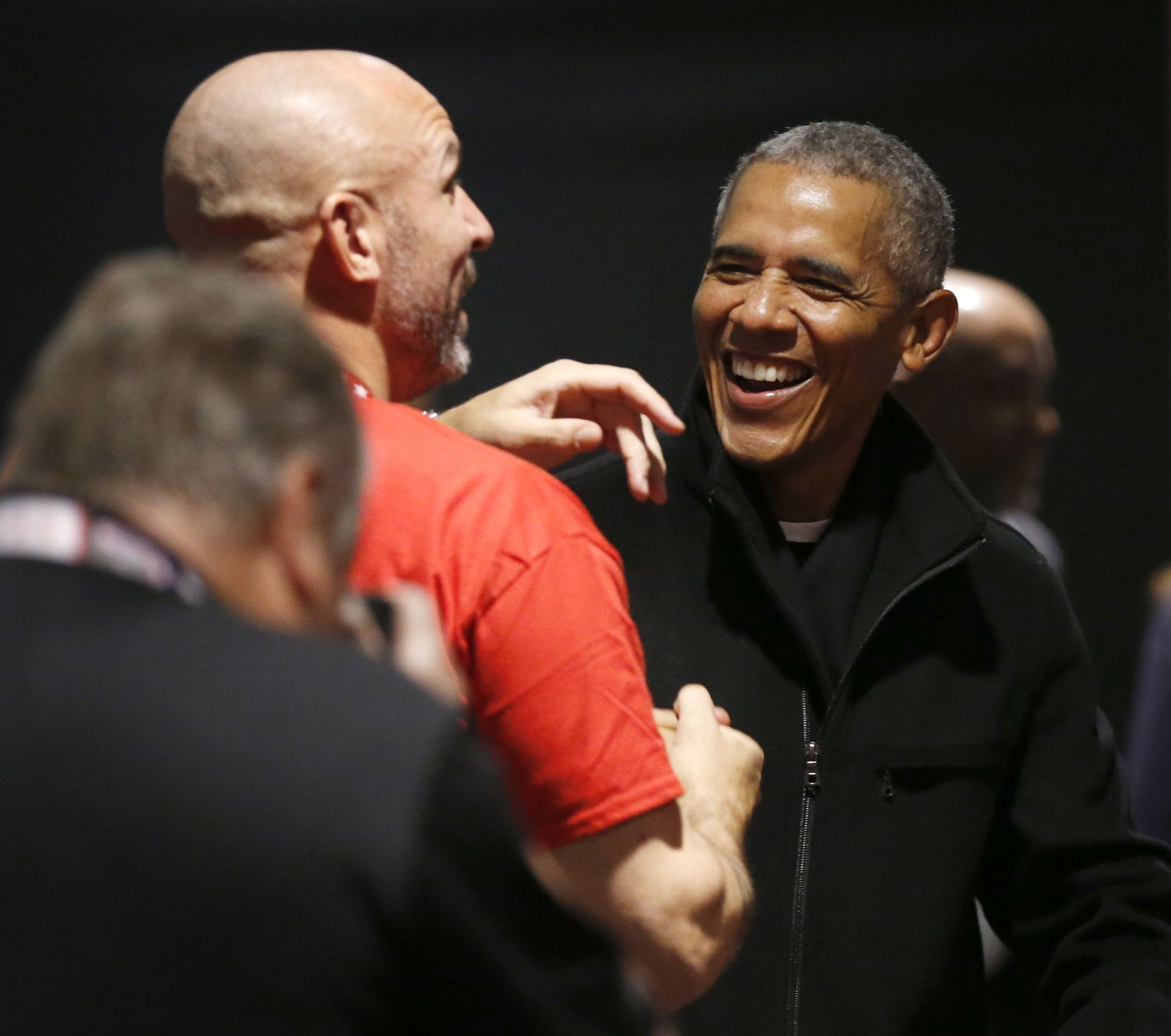 Former President Barack Obama jokes with Los Angeles Lakers assistant coach Jason Kidd as he talks about Dallas Mavericks forward Luka Doncic (77) during a NBA Cares Day of Service event during NBA All Star 2020 at Wintrust Arena in Chicago on Friday, February 14, 2020.