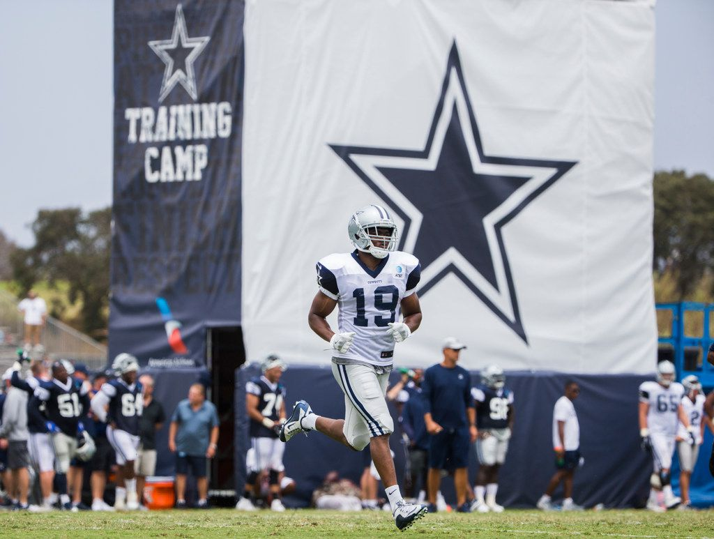 Dallas Cowboys wide receiver Amari Cooper (19) runs across the field during a morning practice at training camp in Oxnard, California on Tuesday, July 30, 2019. (Ashley Landis/The Dallas Morning News)