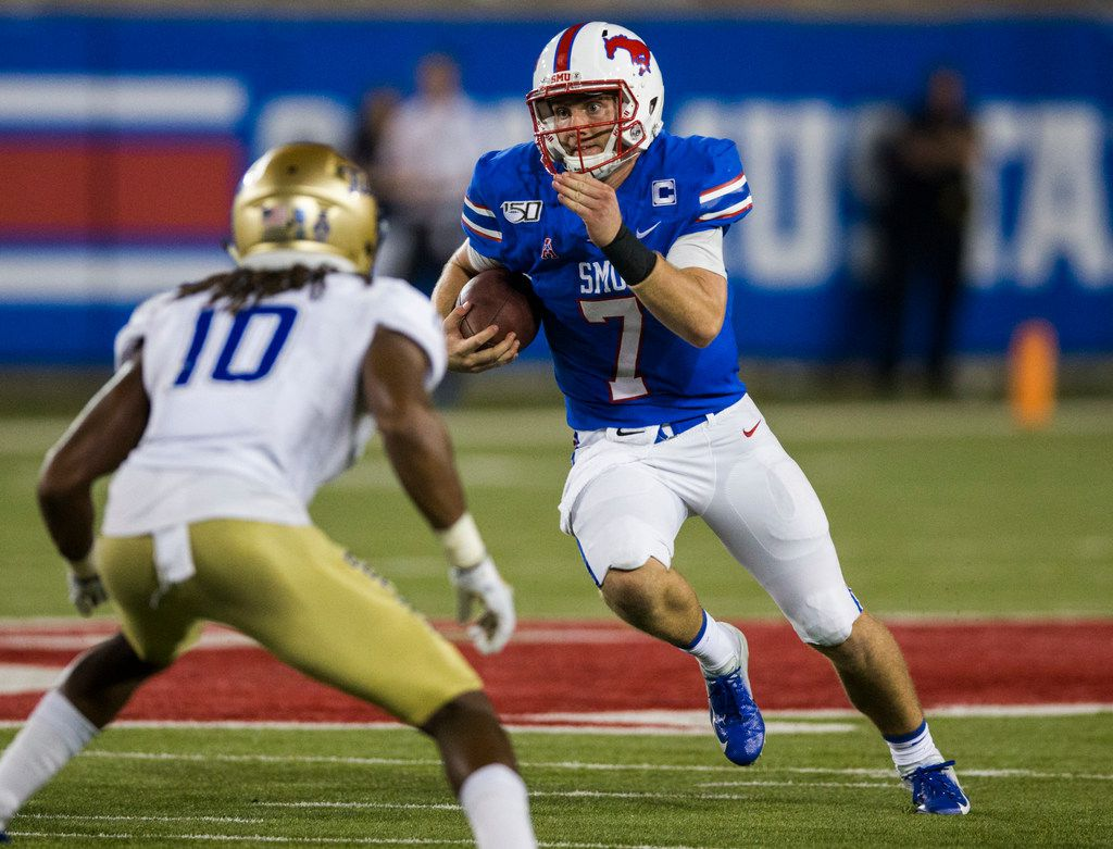 SMU Mustangs quarterback Shane Buechele (7) runs the ball during the fourth quarter of an NCAA football game between Tulsa and SMU on Saturday, October 5, 2019 at Ford Stadium on the SMU campus in Dallas. (Ashley Landis/The Dallas Morning News)